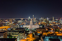 This is a aerial cityscape image of Austin at night of the Texas State Capitol which you don't see to often from this view.  This big views let you see all of the downtown area, you can see all the way down and up Congress Ave and see the citie's high-rises skyscrapers like the Frost and the Austonian in the background.