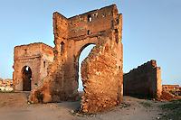 Low angle view of ruined Merenid Tombs, 14th century, Fez, Morocco, pictured on February 25, 2009 in the morning. The tombs, built for the Merenid sultans and now in ruins, are situated on the hillside north of Fez, Morocco's second largest city, and one of the four imperial cities, which was founded in 789 by Idris I on the banks of the River Fez. The oldest university in the world is here and the city is still the Moroccan cultural and spiritual centre. Fez has three sectors: the oldest part, the walled city of Fes-el-Bali, houses Morocco's largest medina and is a UNESCO World Heritage Site;  Fes-el-Jedid was founded in 1244 as a new capital by the Merenid dynasty, and contains the Mellah, or Jewish quarter; Ville Nouvelle was built by the French who took over most of Morocco in 1912 and transferred the capital to Rabat. Picture by Manuel Cohen.