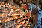 June 12, 2016; Tim Malott, Grotto caretaker, removes burned out candles. (Photo by Matt Cashore/University of Notre Dame)