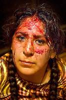 A portrait of 29 year old wrestler Martha La Altena (fighting name), Yenny Wilma Maraz (real name) after a fight at the Multifuncional building. Esperanza is a Cholita, a wrestler of native Aymara descent. When Cholitas fight they wear traditional costume. The blood on her face is believed to be fake, but the fighters insist that it is real. Yenny fights with the lucha libre (free wrestling) group Los Titanes del Ring. .....