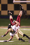 4 November 2006: Boston College's Jon Loyte (front) is upended by Wake Forest's Josh Gattis (behind). Wake Forest defeated Boston College 21-14 at Groves Stadium in Winston-Salem, North Carolina in an Atlantic Coast Conference college football game.