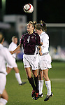 Boston College's Caroline Walden (4) and Duke's Kelly  Hathorn (r) challenge for a header on Wednesday, November 2nd, 2005 at SAS Stadium in Cary, North Carolina. The Duke University Blue Devils defeated the Boston College Eagles 2-0 during their Atlantic Coast Conference Tournament Quarterfinal game.
