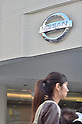 November 2nd, 2011, Tokyo, Japan - Pedestrians in the Ginza district of Tokyo walk past Nissan's showroom. Nissan Motor Co today announced its Q2 operating profit. This fell 4.6 percent but  beat expectations. This is positive for the company in a time of a strong yen, shaky global economy and flooding in Thailand.