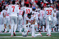 Ohio State Buckeyes linebacker Malik Harrison, center, prays in the end zone before the start of a NCAA Division I college football game between the Ohio State Buckeyes and the Maryland Terrapins on Saturday, November 12, 2016 at Maryland Stadium in College Park, Maryland. (Joshua A. Bickel/The Columbus Dispatch)