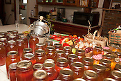 August 7, 2010. Hillsborough, North Carolina.. Christine Green's kitchen counter is full of fruits and vegetables that she grew that she has canned for storage.. Ms. Green grows many fruits and vegetables, has goats and cows and produces at home a large part of the food her family consumes.