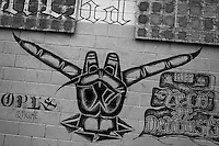 """A Mara Salvatrucha gang graffiti (""""Devil's horns"""") painted on the wall of the prison in Tonacatepeque, El Salvador, 18 May 2011. During the last two decades, Central America has become the deadliest region in the world that is not at war. According to the UN statistics, more people per capita were killed in El Salvador than in Iraq, in recent years. Due to the criminal activities of Mara Salvatrucha (MS-13) and 18th Street Gang (M-18), the two major street gangs in El Salvador, the country has fallen into the spiral of fear, violence and death. Thousands of Mara gang members, both on the streets or in the overcrowded prisons, organize and run extortions, distribution of drugs and kidnappings. Tattooed armed young men, mainly from the poorest neighborhoods, fight unmerciful turf battles with their coevals from the rival gang, balancing between life and death every day. Twenty years after the devastating civil war, a social war has paralyzed the nation of El Salvador."""