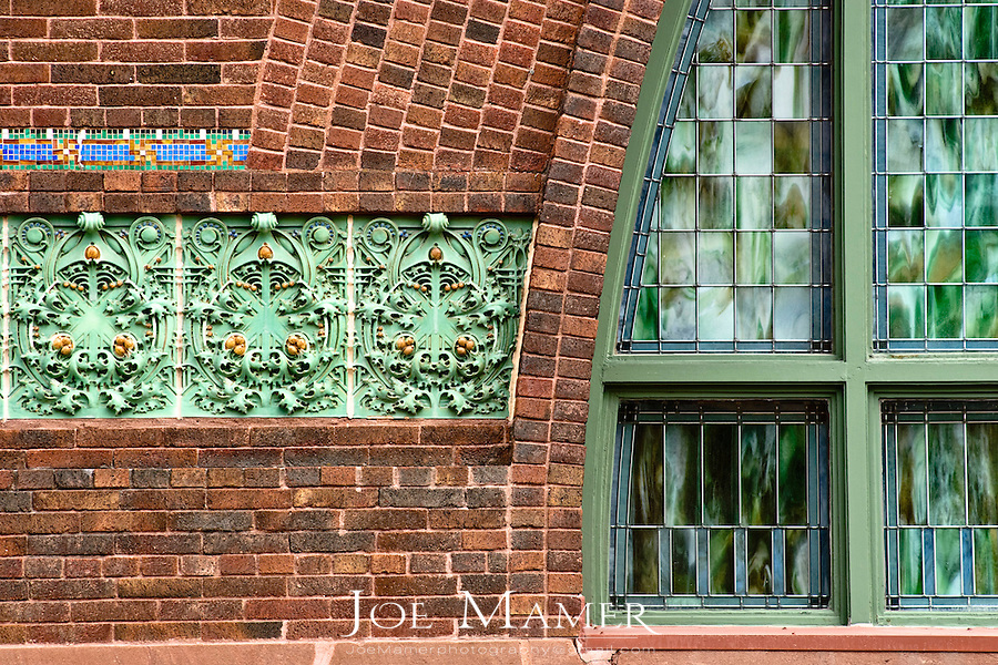 """Exterior terra cotta detail of the National Farmers' Bank of Owatonna, Minnesota. The bank was built in 1908. Designed by Louis Sullivan with decorative elements by George Elmslie it was the first of Sullivan's """"jewel boxes"""". The exterior windows were designed by Louis J. Millet..."""