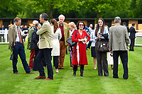 Owners and trainers enjoying themselves in the parade ring during Afternoon Racing at Salisbury Racecourse on 18th May 2017