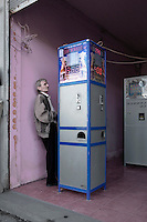A man plays a slot machine in Batumi...
