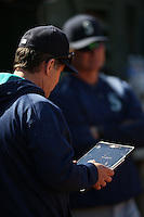 OAKLAND, CA - SEPTEMBER 10:  Hitting coach Edgar Martinez #11 of the Seattle Mariners looks at an Apple iPad in the dugout during the game against the Oakland Athletics at the Oakland Coliseum on Saturday, September 10, 2016 in Oakland, California. Photo by Brad Mangin