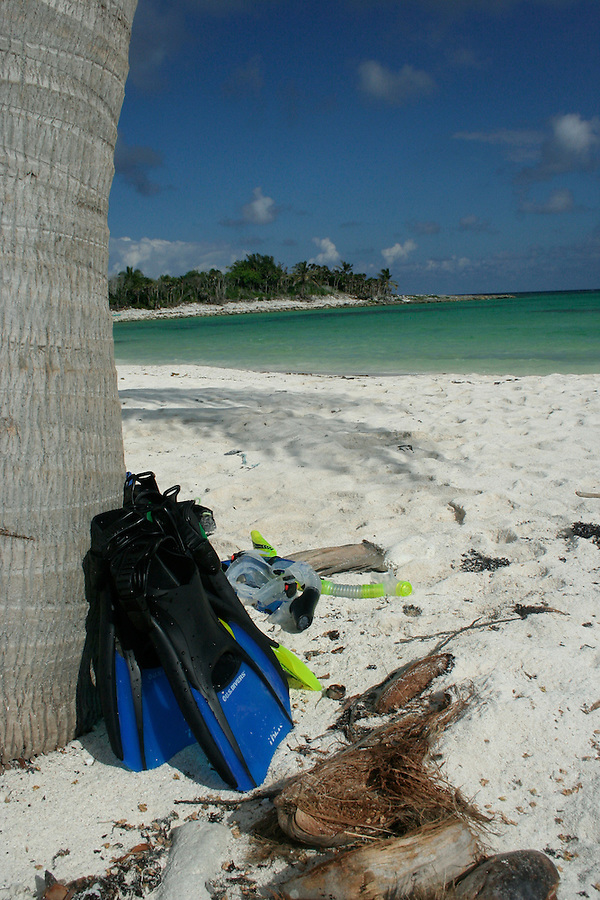 On a secluded beach in Mexico, snorkel gear awaits use.  This beach in Akumal, Quintana Roo, on the Yucatan peninsula is in a calm and protected bay and sees a handful of visitors at a time.