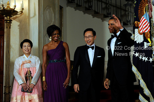 United States President Barack Obama and First Lady Michelle Obama stand with South Korean President Lee Myung-bak and Lee's wife Kim Yoon-ok in the Cross Hall as they arrive for a State Dinner at the White House in Washington, DC on Thursday, October 13, 2011. The State Visit comes only a day after Congress passed a free trade agreement with South Korea.   .Credit: Roger L. Wollenberg / Pool via CNP