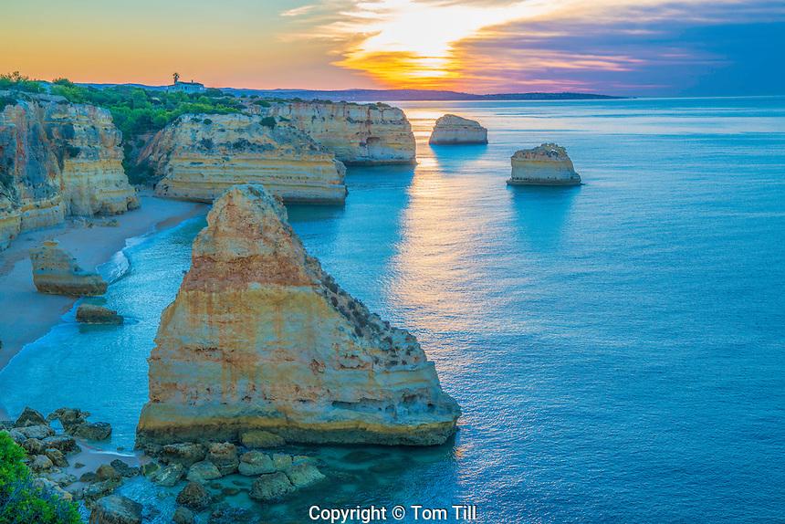 Sea stacks at sunrise on Algrave Coast, Portugal, Atlantic Ocean   Near Lagoa