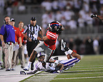 Ole Miss defensive back Frank Crawford (5) intercepts a pass and is chased out of bounds by Central Arkansas' Chase Dixon (89) at Vaught-Hemingway Stadium in Oxford, Miss. on Saturday, September 1, 2012.