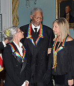 Washington, DC - December 6, 2008 -- Twyla Tharp, left, Morgan Freeman, center, and Barbra Streisand, right, share conversation as they prepare to pose for the formal group photo following the Artist's Dinner at the United States Department of State in Washington, D.C. on Saturday, December 6, 2008 to honor 2008 recipients of the Kennedy Center Honors..Credit: Ron Sachs - Pool via CNP