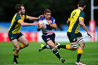 Samuel Pointon of Great Britain takes on the Australia defence. FISU World University Championship Rugby Sevens Men's Cup Final between Australia and Great Britain on July 9, 2016 at the Swansea University International Sports Village in Swansea, Wales. Photo by: Patrick Khachfe / Onside Images