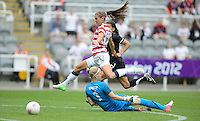 Newcastle, England - Friday, August 3, 2012: The USA women defeated New Zealand 2-0 in the quarterfinal round of the 2012 Olympics at St. James Park. Alex Morgan vaults over goalie Jenny Bindon (1).