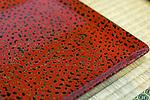 Photo shows a detail of a Tsugaru lacquerware product on sale at Tanaka-ya in Hirosaki, Japan on 18 Jan. 2013. The product shown is a square plate. Photo: Robert Gilhooly..