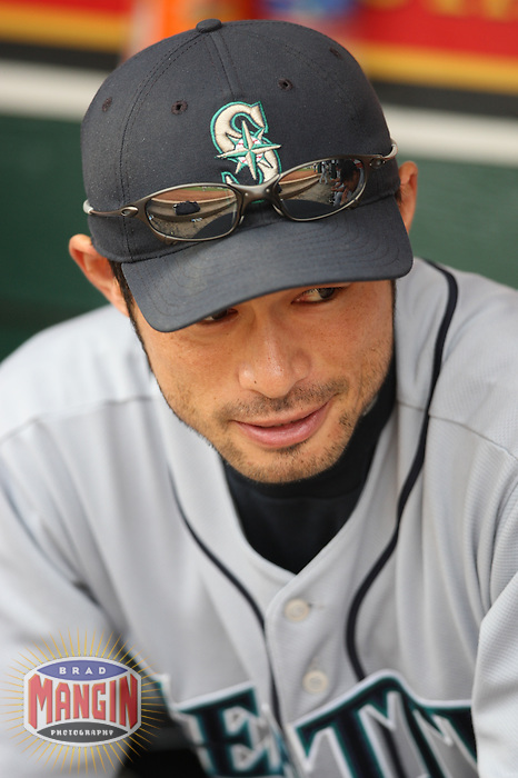 OAKLAND, CA - SEPTEMBER 20:  Ichiro Suzuki of the Seattle Mariners gets ready in the dugout before the game against the Oakland Athletics at the McAfee Coliseum in Oakland, California on September 20, 2008.  The Athletics defeated the Mariners 8-7.  Photo by Brad Mangin