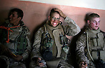 Exhausted Marines from Lima Co. 3rd Battalion 6th Marines hold in a house for a few moments after the battalion pushed into Karabilah from its attack positions outside the city to start the final push to clear the city during the sixth day of Operation Steel Curtain on Thurs. 10, 2005.