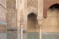 Carved stucco walls in the Al-Attarine Madrasa, a religious school built 1323-25 by the Marinid Sultan Uthman II Abu Said, who ruled 1310-31, in the medina of Fes, Fes-Boulemane, Northern Morocco. This intricate carved stucco work surrounds the central courtyard, and zellige tiles cover the lower walls. The medina of Fes was listed as a UNESCO World Heritage Site in 1981. Picture by Manuel Cohen