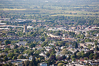Christ Church  & Lansdown Terrace catching the sun centre in aerial view of tree lined streets of Cheltenham Spa Town seen from Leckhampton Hill