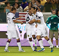 CARSON, CA – August 27, 2011: Real Salt Lake players Luis Gil (21), Arturo Alvarez (10) and Fabian Espindola (7) celebrate Alvaro Saborio's goal during the match between Chivas USA and Real Salt Lake at the Home Depot Center in Carson, California. Final score Chivas USA 0, Real Salt Lake 1.