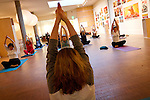 "Participants in the weekly Yoga in Faulconer Gallery group practice a meditative ""mudra"" or gesture on Thursday in the Bucksbaum Center for the Arts."