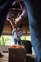 Leonardo and Felix mushing cooked agave as part of the mezcal making process, Felix Garcia´s ranch and distillery in El Potrero, Oaxaca, Oaxaca, Mexico