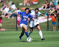 Mollie Pathman (24) of Duke fights for the ball with Emily Carrollo (19) of Virginia during the game at Klockner Stadium in Charlottesville, VA.  Virginia defeated Duke, 1-0.