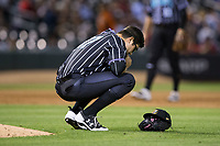 Charlotte Knights relief pitcher Matt Purke (37) says a little prayer behind the mound during the game against the against the Norfolk Tides at BB&T BallPark on May 2, 2017 in Charlotte, North Carolina.  The Knights defeated the Tides 8-3.  (Brian Westerholt/Four Seam Images)