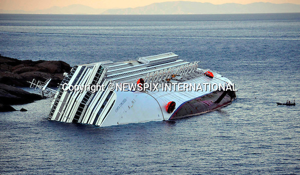 """Isola del Giglio, Italy_15/01/2012:  COSTA CONCORDIA RUNS AGROUND.The Costa Concordia, which was carrying more than 4,000 passengers, experienced trouble a few hundred metres from the tiny Tuscan holiday island of Giglio on Friday evening as the passengers were at dinner, after apparently sailing off course.Desperate passengers scrambled to evacuate the stricken vessel as it began to take on water and list to the right, with some opting to jump into the sea..A massive coastguard rescue operation involving helicopters and rescue boats was immediately launched.At daybreak, the ship could be seen almost completely on its side..Mandatory Credit Photo: ©Bramo-Sestini/NEWSPIX INTERNATIONAL..**ALL FEES PAYABLE TO: """"NEWSPIX INTERNATIONAL""""**..IMMEDIATE CONFIRMATION OF USAGE REQUIRED:.Newspix International, 31 Chinnery Hill, Bishop's Stortford, ENGLAND CM23 3PS.Tel:+441279 324672  ; Fax: +441279656877.Mobile:  07775681153.e-mail: info@newspixinternational.co.uk"""