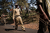 Equipped with axe, bows and arrows, the  Special Police Officers (SPO) patrol the jungles in Bijapur area in Chhattisgarh, India. Photo: Sanjit Das/Panos for The Times
