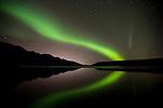 Symmetric Aurora Borealis over lake Kleifarvatn, south-west Iceland