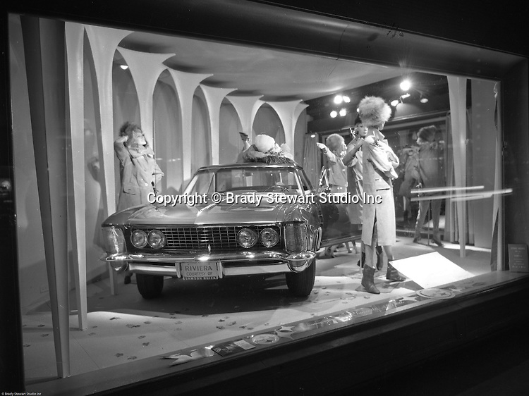 Pittsburgh PA: View of Christmas window display at Horne's department store in Pittsburgh. New Buick Riviera on display during the Rhapsody of Steel campaign.  US Steel launched an awareness campaign of all the current uses of steel in everyday products.  During this time, ALCOA Aluminum Company of America also headquartered in Pittsburgh, was aggressively competing to enter markets where US  steel companies traditional dominated market share. Examples included beer and food Cans, appliances, automobile parts, children toys / bicycles, and more.