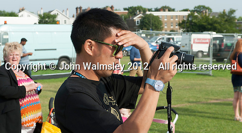 "Dan Tsu, driving force behind Lyrix Organix (www.lyrixorganix.com), at ""Showtime"", part of the London 2012 Festival of Arts to celebrate the London Olympics.  A family fun spectacle including dance, painting, music, acrobatics and some large mobile dynosaurs walking amongst the crowd.  On Blackheath Common, Saturday August 4th and funded by the Mayor of London and Arts Council England."
