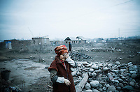 A poor migrant woman living in the outskirt of Bishkek.
