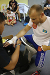 Igor Svirid, One middleweight world champion from Kazakstan in Red locker room getting hands bandaged and practicing before fight<br />