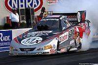 INDIANAPOLIS, IN - SEPTEMBER 6: John Force drives his Funny Car during the NHRA Mac Tools US Nationals on September 6, 2002, at Raceway Park near Indianapolis, Indiana.
