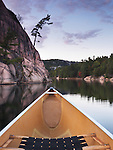 Canoeing on lake George in fall. Killarney Provincial Park, Ontario, Canada.