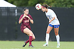 29 September 2013: Duke's Laura Weinberg (16) heads the ball past Virginia Tech's Jordan Coburn (19). The Duke University Blue Devils hosted the Virginia Tech University Hokies at Koskinen Stadium in Durham, NC in a 2013 NCAA Division I Women's Soccer match. The game ended in a 1-1 tie after two overtimes.