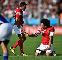 Hale T Pole of Tonga high-fives tea-mate Siale Piutau. Rugby World Cup Pool C match between Tonga and Namibia on September 29, 2015 at Sandy Park in Exeter, England. Photo by: Patrick Khachfe / Onside Images