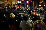 A woman exits a limousine as anti-GOP demonstrators participate in a dance party flash mob through the streets of Ybor City during the 2012 Republican National Convention in Tampa, Fla.