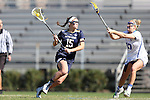 DURHAM, NC - FEBRUARY 26: Notre Dame's Cortney Fortunato (15) and Duke's Devon Russell (17). The Duke University Blue Devils hosted the University of Notre Dame Fighting Irish on February, 26, 2017, at Koskinen Stadium in Durham, NC in a Division I College Women's Lacrosse match. Notre Dame won the game 12-11.