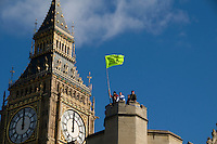 Greenpeace activists on the roof of the Houses of Parliament in London to demand politicians pay more attention to climate change. They stayed for over 24 hours.