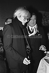 December 31, 1986:  Andy Warhol celebrates his last New Year's Eve with a dinner at Cafe Roma restaurant in New York City, New York.  Warhol died less than two months later on February 22, 1987..