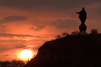 October 17th 2003_ DILI, TIMOR-LESTE_ Views of a twenty meter tall statue of Jesus, known as Cristo Rei sit's on a hill near the Timorese capital city of Dili.  Photograph by Daniel J. Groshong/Tayo Photo Group