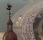 5/3/01 Al Diaz/Herald Staff--The Miami Club Med Corporate Run winds across the Port of Miami Bridge as the Freedom Tower looms in the foreground. Thousands of runners braved a downpour to complete the 3.1 mile road race.