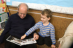 """Berkeley CA Grandpa reading to grandson, four-years-old during """"Grandparents"""" Day"""" at preschool  MR"""