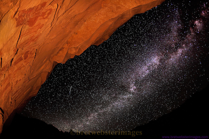A shooting star and the Milky Way decorate a panel of mysterious beings conjuring images of ancient aliens in Sego Canyon, Utah.